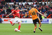 Nottingham Forest midfielder Henri Lansbury (10) takes a shot during the Sky Bet Championship match between Nottingham Forest and Wolverhampton Wanderers at the City Ground, Nottingham, England on 30 April 2016. Photo by Jon Hobley.