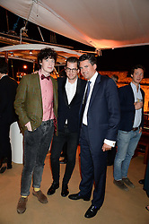 Johnnie Walker Gold Label Reserve Finale Celebration Party aboard the John Walker & Sons Voyager moored at the Prince of Wales Docks, Leith, Edinburgh, Scotland on 14th August 2013.<br /> Picture shows:-Left to right, Michael Pedersen, Jonathan Freemantle and Edward Taylor