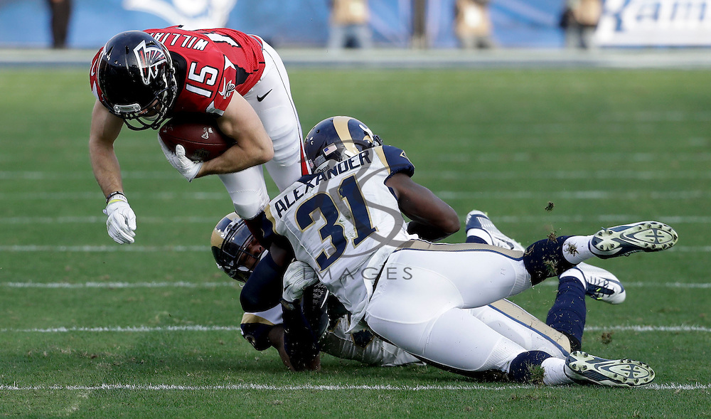 Los Angeles Rams cornerback Trumaine Johnson, left, and free safety Maurice Alexander, right, tackle Atlanta Falcons wide receiver Nick Williams during the second half of an NFL football game Sunday, Dec. 11, 2016, in Los Angeles. Alexander was injuried on the play. (AP Photo/Rick Scuteri)