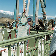 12 April 1976<br /> Kabul. Short shot of last slide, a man beside the shrine, snowy mountains in the background.