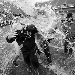 047-State Championship<br /> Northside High School football head football coach, Burt Torrence (middle) is doused with Gatorade after the Region III State High School Football Championship game against Bruton High School Saturday in Blacksburg. Northside defeated Bruton 20-17 to win the first football state championship in school history.