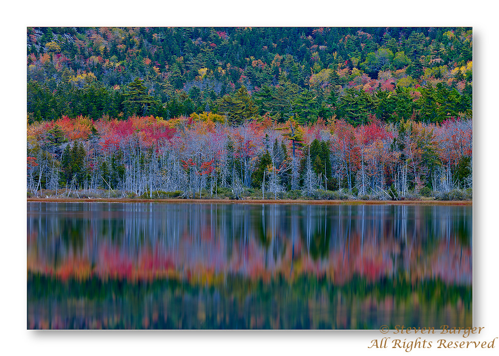Photograph of Hadlock Pond in Northeast Harbou on Mount Desert Isalnd Maine with the fall colors reflected in the pond