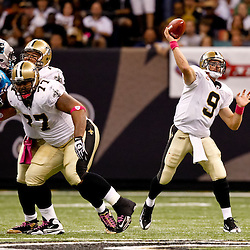 October 3, 2010; New Orleans, LA, USA; New Orleans Saints quarterback Drew Brees (9) throws a pass against the Carolina Panthers during the second quarter at the Louisiana Superdome. Mandatory Credit: Derick E. Hingle