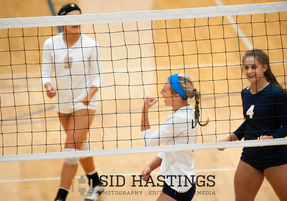 25 AUG. 2015 -- ST. CHARLES, Mo. -- St. Pius X High School volleyball players Jena Otec (9), Elle Russell (11) and Shelby Meyer (4) celebrate after scoring against Duchesne High School during the match between the two schools at Duchesne in St. Charles, Mo. Tuesday, Aug. 25, 2015. St. Pius won, 2-0 (25-14, 25-23), to advance to 6-0. It was Duchesne's first match, dropping them to 0-1 on the year. Photo © copyright Sid Hastings.