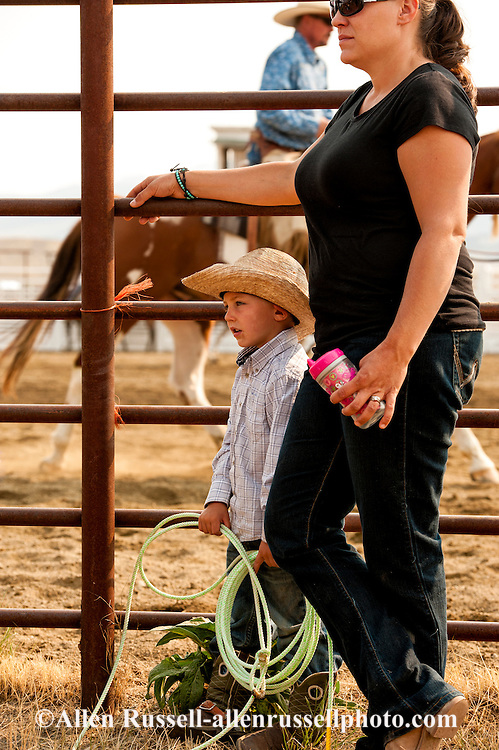 Wilsall Ranch Rodeo, kids dummy roping competition, mom with son, Wilsall, Montana