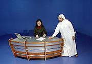 Al Jazeera presenter Jelnar Moussa prepares to broadcast, Al Jazeera arabic satellite news channel, Doha, Qatar, Middle East, Persian Gulf