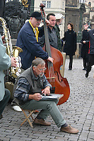 Jazz musicians busking on The Karluv, Charles medieval Bridge, Prague, River Vltava, Czech Republic<br />