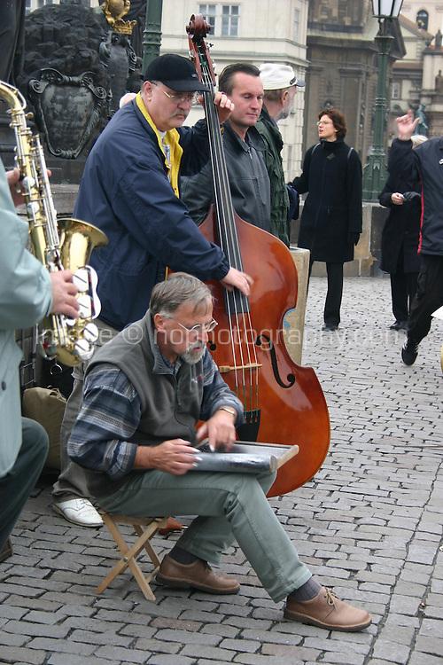 Jazz musicians busking on The Karluv, Charles medieval Bridge, Prague, River Vltava, Czech Republic<br />