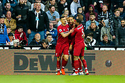 Virgil van Dijk (#4) of Liverpool celebrates Liverpool's first goal (0-1) with Georginio Wijnaldum (#5) of Liverpool and Dejan Lovren (#6) of Liverpool during the Premier League match between Newcastle United and Liverpool at St. James's Park, Newcastle, England on 4 May 2019.
