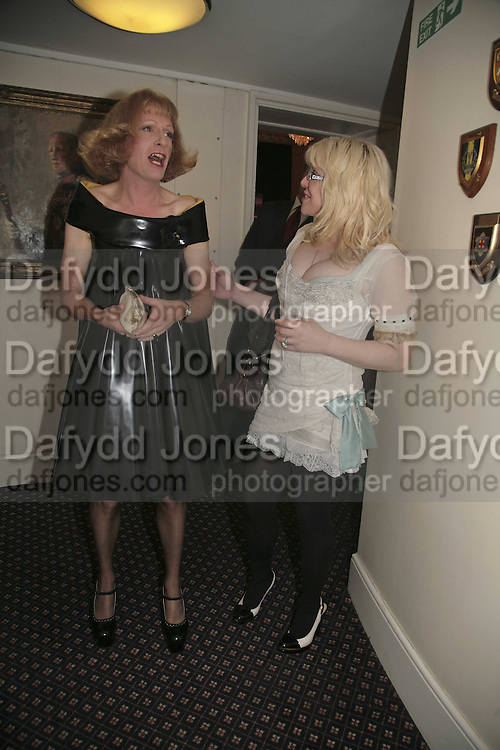 PRESENTER OF LAST YEAR'S PRIZE GRAYSON PERRY AND THIS YEAR'S PRESNETER COURTNEY LOVE, Literary Review's Bad Sex In Fiction Prize.  In &amp; Out Club (The Naval &amp; Military Club), 4 St James's Square, London, SW1, 29 November 2006. <br />