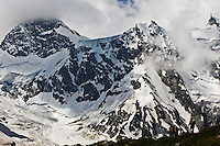 Russia, Caucasus, Hikers under dramatic mountains in Adylsu valley, a side valley to Baksan and Elbrus.