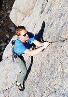 A man rock climbing at The Pearly Gates climbing area in Icicle Canyon above Leavenworth, Washington, USA.