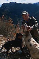 ca. March, 1999, near Norcia, Umbria, Italy --- Truffle Hunter Removing a Truffle from His Dog's Mouth --- Image by © Owen Franken/CORBIS