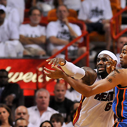 Jun 17, 2012; Miam, FL, USA; Miami Heat small forward LeBron James (6) passes as Oklahoma City Thunder shooting guard Thabo Sefolosha (2) defends during the first quarter in game three in the 2012 NBA Finals at the American Airlines Arena. Mandatory Credit: Derick E. Hingle-US PRESSWIRE