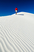 Hiker and gypsum dune patterns, White Sands National Park, New Mexico USA