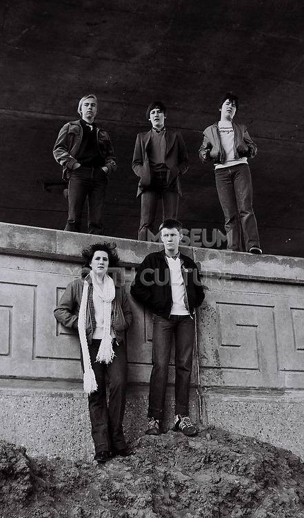 Five teenage friends stand under the newly built A40 flyover. London, Greenford, UK, 1980s.