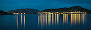 The island Remøy, on the vestern part of Norway by night, with the Remøy Bridge in the middle of the picture. Panorama stiched by two exposures | Remøy i Herøy kommune i natten, med Remøybrua i midten av bildet. Panorama sett sammen av to eksponeringer.