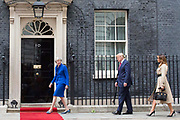 UNITED KINGDOM, London: 04 June 2019 <br /> The British Prime Minister Theresa May walks President Donald Trump and his wife Melania up to No 10 Downing Street to welcome them during The President's official state visit.
