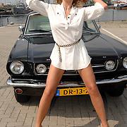NLD/Amsterdam/20070610 - Presentatie Playboy's Playmates Collectors Special Edition, playmate en model Melisa Schaufeli met de auto van Frans van Zoest, Spike