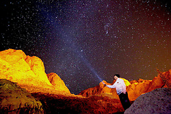 A tourist with a flashlight enjoys the view of Mount Sinai, at the foot of which locates the Saint Catherine's Monastery, in Saint Catherine, South Sinai Province, Egypt, Dec 27, 2014. The site is popular among visitors from around the world who come to see the Saint Catherine's Monastery, a UNESCO World Heritage Site said to be where Moses received the stone tablets bearing the Ten Commandments. EXPA Pictures © 2014, PhotoCredit: EXPA/ Photoshot/ Ahmed Gomaa<br /> <br /> *****ATTENTION - for AUT, SLO, CRO, SRB, BIH, MAZ only*****