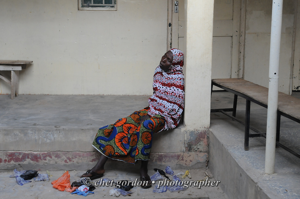 A Nigerian woman waits to see American doctors at the Murtala Muhammad Specialist Hospital in Kano, Nigeria on Monday, December 3, 2012.