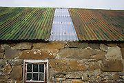 Corrugated iron roof of semi-derelict crofter's outbuilding in hamlet of Waterloo, Isle of Skye, Scotland.