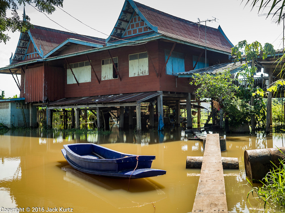 30 SEPTEMBER 2016 - SAI NOI, AYUTTHAYA, THAILAND:  A flooded home in Sai Noi. The Chao Phraya River, the largest river that runs through central Thailand, has hit flood stage in several areas in Ayutthaya and Ang Thong provinces. Villages along the river are flooded and farms are losing their crops due to the flood. This is the same area that was devastated by floods in 2011, but the floods this year are not expected to be as severe. The floods are being fed by water released from upstream dams. The water is being released to make room for heavy rains expected in October.     PHOTO BY JACK KURTZ