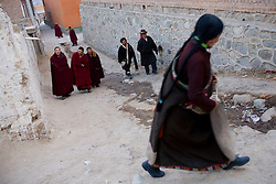 Tibet New Year - China - Edward Wong<br /> Tibetans make their way through Rongwo monastery  (Longwu in Chinese) in Rebkong (Tongren in Chinese), Qinghai province in China, February 23, 2009. Photo by Shiho Fukada for The New York Times