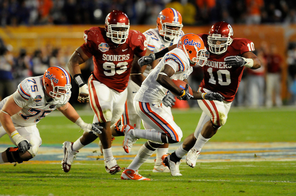January 8, 2009: Mike Balogun and Gerald McCoy of the Oklahoma Sooners chase Chris Rainey of the Florida Gators during the NCAA football game between the Florida Gators and the Oklahoma Sooners in the 2009 BCS National Championship Game. The Gators defeated the Sooners 24-14.