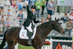 Mina CHINJU riding Sandro's Serendipity in the Grade 1a Para-Dressage at the 2014 World Equestrian Games, Caen, Normandy, France..