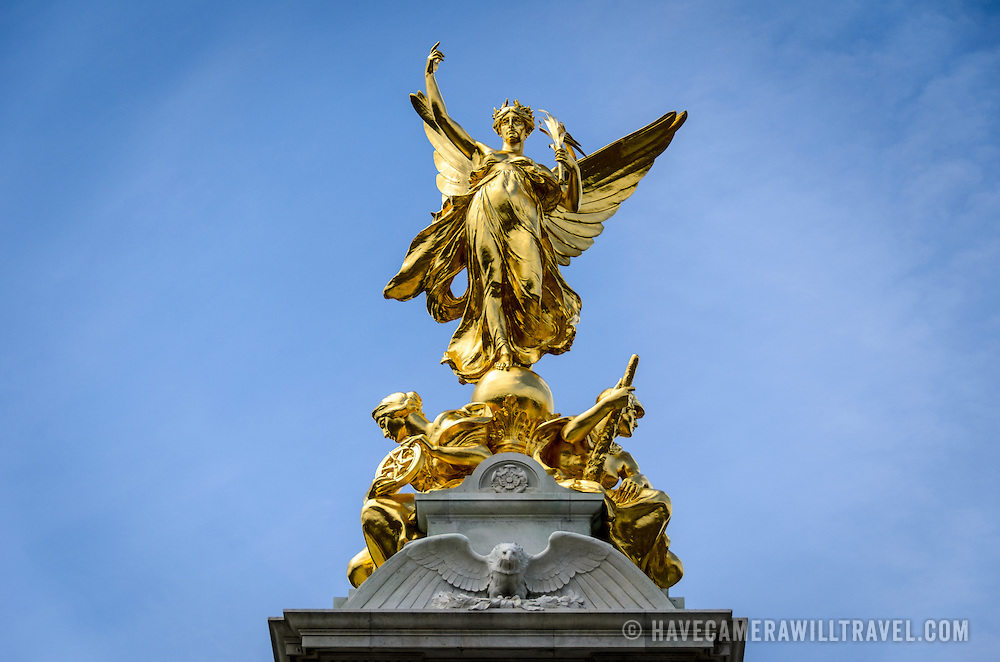 Victoria Memorial Buckingham Palace London Gold Statue 169-110750706 The Victoria Memorial, dedicated to Queen Victoria, sits directly in front of Buckingham Palace, with Queen Victoria facing The Mall.