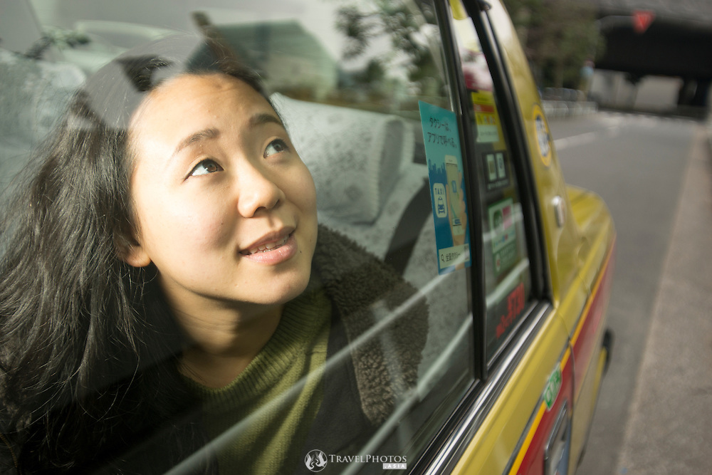A young Japanese lady in a Tokyo taxi.