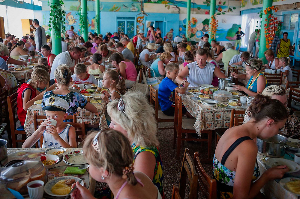 Tourists eat lunch in a canteen in Zatoka, a cheap Black Sea resort destination in Ukraine popular with Moldovians.