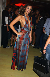 SERENA MATTAR at a fashion show by ISSA held at Cocoon, 65 Regent Street, London on 21st September 2005.<br />