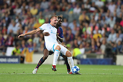 September 18, 2018 - Barcelona, Catalonia, Spain - Samuel Umtiti of FC Barcelona duels for the ball with Luuk De Jong of PSV Eindhoven during the UEFA Champions League, Group B football match between FC Barcelona and PSV Eindhoven on September 18, 2018 at Camp Nou stadium in Barcelona, Spain (Credit Image: © Manuel Blondeau via ZUMA Wire)