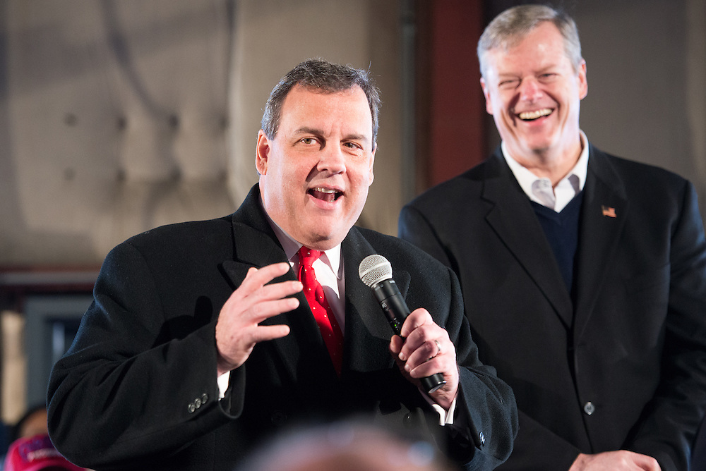 Republican presidential candidate and N.J. governor CHRIS CHRISTIE speaks at a rally in Bedford, N.H. to encourage primary voters to vote for him on Tuesday. Behind him stands Mass. governor CHARLIE BAKER, CHRISTIE's most recent major endorsement.