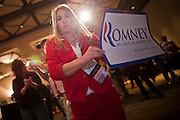 28 FEBRUARY 2012 - PHOENIX, AZ:     HEIDI HENDERSON, a Mitt Romney supporter from Florida, dances during a Romney primary election watch party in Phoenix. Several hundred Romney supporters crowded into a ballroom in a Phoenix hotel to watch primary results from Michigan and Arizona. Romney won the night, scoring a tight win in the Michigan Republican Presidential primary and a comfortable win in the Arizona Republican Presidential primary.     PHOTO BY JACK KURTZ