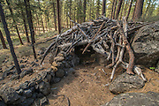 A small shelter built in the middle of the Deschutes National Forest, Oregon. The location is used as a geocache stash site.