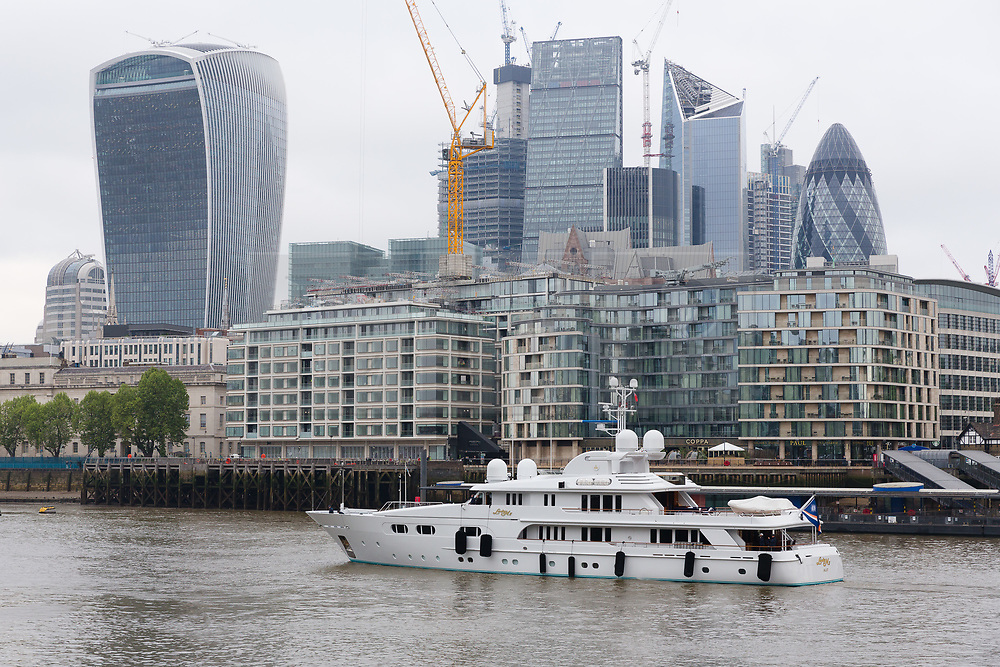 © Licensed to London News Pictures. 16/05/2018. London, UK. Superyacht, Lady M II passes City of London skyscrapers this morning before mooring next to HMS Belfast. The 164 feet long superyacht, Lady M II (previously named Lady M) is rumoured to be owned by politician and businessman, Lord Ashcroft. A different superyacht, called Lady M visited Glasgow and Cumbria last year and was reported to be owned by Russia's richest Billionaire, Alexi Mordashov. Lady M II sleeps up to 11 guests in 6 rooms and is also capable of carrying up to 12 crew onboard. Lady M II was designed by Donald Starkey with various luxuries onboard, including a deck jacuzzi and is advertised for charter at USD180,000 per week plus expenses. Photo credit: Vickie Flores/LNP