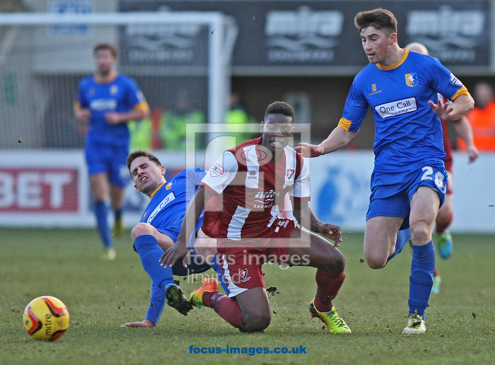 Picture by Mark Hawkins/Focus Images Ltd 07949 023795<br /> 29/12/2013<br /> Jermaine Mcglashan of Cheltenham Town is felled by Chris Clements of Mansfield Town (left) during the Sky Bet League 2 match at the Abbey Business Stadium, Cheltenham.