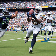 14 September 2014: San Diego Chargers TE Antonio Gates (85)  hauls in a TD reception from QB Philip Rivers (not pictured) in front of Seattle Seahawks LB Malcolm Smith (53) during the NFL game between the San Diego Chargers and the Seattle Seahawks at Qualcomm Stadium in San Diego, CA.