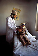 Pakistan Peshawar  1986..Doctor Afghan visit a Young Afghan Boy in Refugee Camp