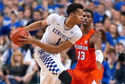 Kentucky forward Skal Labissiere, left, looks for an open teammate with pressure from Florida forward Kevarrius Hayes in the second half.<br /> <br /> The University of Kentucky hosted the University of Florida, Saturday, Feb. 06, 2016 at Rupp Arena in Lexington .
