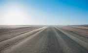 endless road in the Namibian desert safari, Namibia