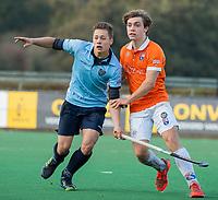 BLOEMENDAAL  -  Victor Bombeeck (Nijmegen) met Daan van Os (Bldaal)  , competitiewedstrijd junioren  landelijk  Bloemendaal JA1-Nijmegen JA1 (2-2) . COPYRIGHT KOEN SUYK