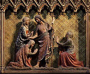 Jesus appears before the Holy women with a cross, on the South choir screen, 1351, by Jean le Bouteiller, carved polychrome wood with 9 scenes of the apparitions of Christ after his resurrection, separated by columns, in the Cathedrale Notre-Dame de Paris, or Notre-Dame cathedral, built 1163-1345 in French Gothic style, on the Ile de la Cite in the 4th arrondissement of Paris, France. The choir screen was restored in the 19th century under Viollet le Duc. Photographed on 17th December 2018 by Manuel Cohen