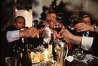 Toasting at a party in St. Emilion © Owen Franken.....