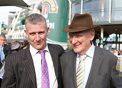 LIVERPOOL, ENGLAND, Saturday, April 9, 2011: Winning trainer Donald McCain with his four-time winning trainer, father Ginger McCain, as he celebrates winning the 2011 Grand National with Ballabriggs during Day Three of the Aintree Grand National Festival at Aintree Racecourse. (Photo by David Tickle/Propaganda)