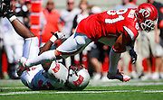 Utah tight end Kendrick Moeai (81) rushes for a first down against UNLV linebacker Ronnie Paulo (36) during the second quarter of an NCAA college football game at Rice-Eccles Stadium, Saturday, Sept. 11, 2010, in Salt Lake City, Utah.  (AP Photo/Colin E. Braley)