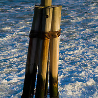 Water crashing around a piling at the Pier 11 Ferry Terminal in Lower Manhattan New York City
